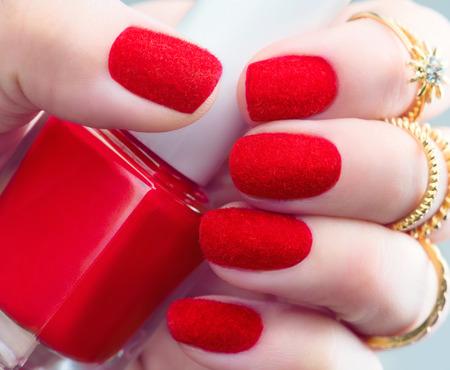 nailart: Velvet nails. Fashion trendy red fluffy nailart design closeup