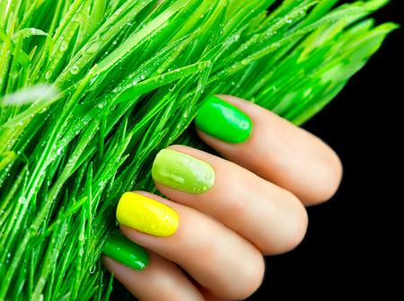 nailart: Spring manicure. Trendy green nails. Beautiful nailpolish with green grass