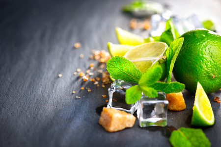 lime: Ingredients of Mojito. Lime, mint, ice cubes and brown sugar