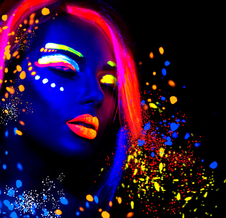 Fashion model woman in neon light, portrait of beautiful model girl with fluorescent make-up