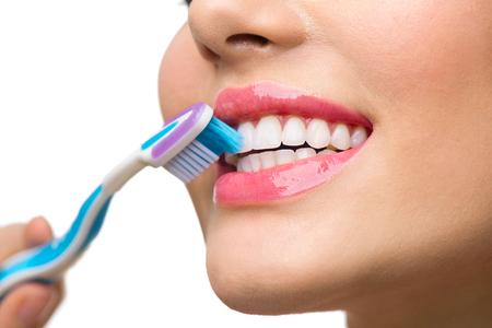Teeth brushing. Beautiful white healthy teeth