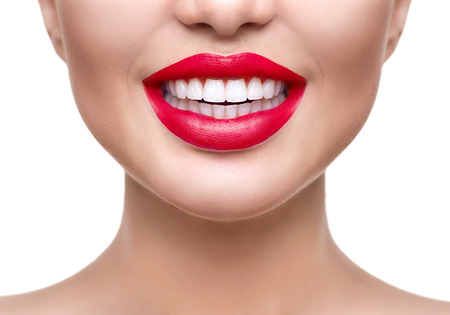 Teeth whitening. Healthy white smile closeup. Beautiful girl with red lips isolated on white