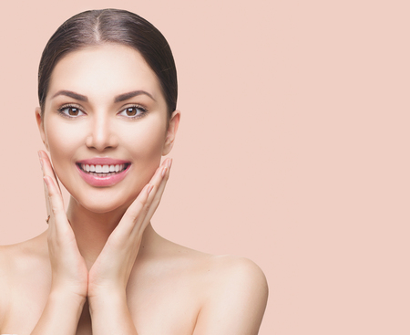 blissful: Beauty spa woman touching her face and smiling Stock Photo