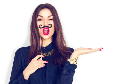 winking: Winking model girl holding funny mustache on stick