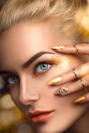nailart: Beauty blonde model sexy girl with perfect golden makeup