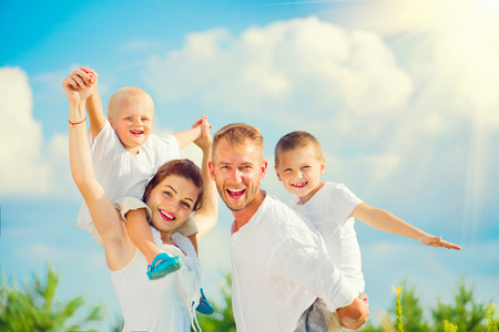 Happy young family with two children having fun together Banco de Imagens - 61732165