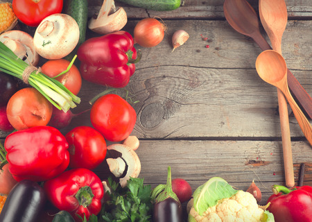 abstract backgrounds: Healthy organic vegetables on wooden background