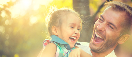Happy joyful young father with his little daughter Stockfoto