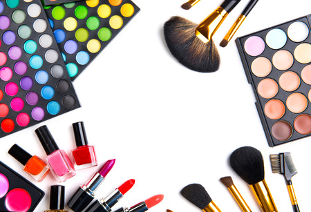 Makeup set palettes with colorful eyeshadows. Various cosmetic brushes