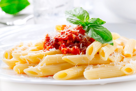 bolognese sauce: Pasta Penne with Bolognese sauce, Parmesan cheese and Basil Stock Photo