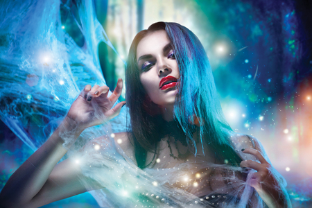 spider web: Halloween vampire woman portrait Stock Photo