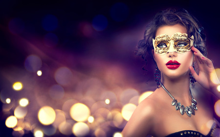 Beauty model woman wearing venetian masquerade carnival mask