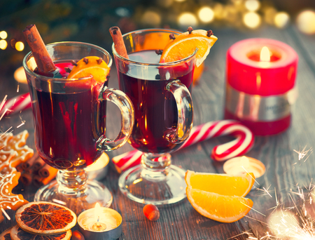 Christmas hot mulled wine with cinnamon stick, slices of orange and spices Stock Photo