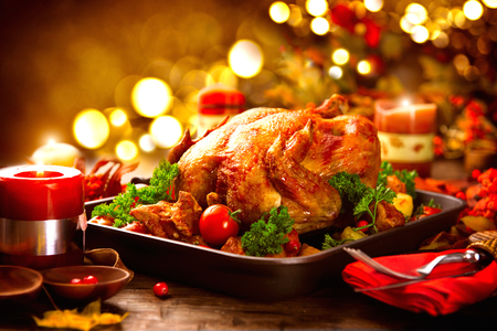served: Thanksgiving table served with turkey, decorated with bright autumn leaves Stock Photo