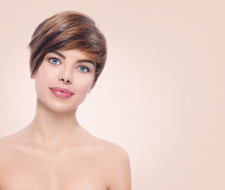 beige: Beautiful young spa woman with short hair portrait