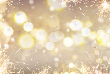 xmas background: Golden Christmas holiday abstract glitter defocused background