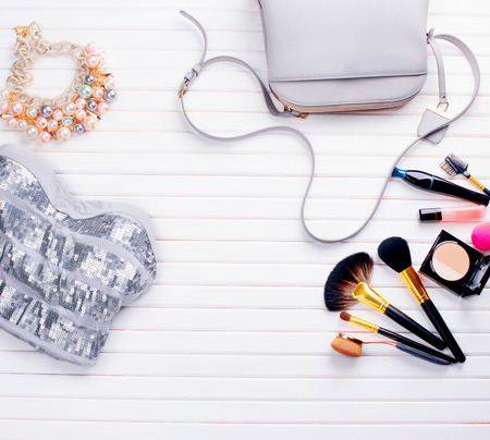 womans clothing: Womans clothing and accessories placed on a wooden background Stock Photo