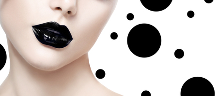 salon: Beauty fashion model girl face with black makeup