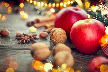 hazelnuts: Christmas holiday background. Decorated wooden table