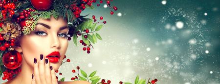 クリスマス女性化粧。冬のファッションの女の子 写真素材