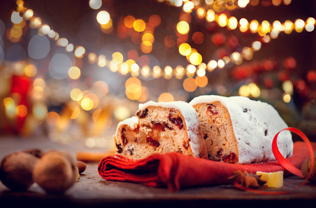 gingerbread: Christmas stollen. Traditional sweet fruit loaf with icing sugar