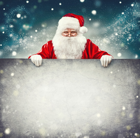 space for text: Santa Claus holding blank advertisement banner background with copy space for text