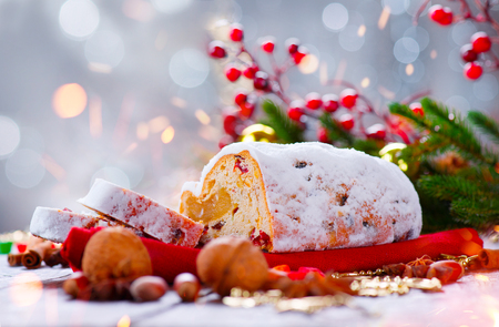 an icing: Christmas stollen. Traditional sweet fruit loaf with icing sugar