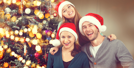 box: Christmas family portrait. Smiling parents with teenage daughter Stock Photo