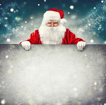 Santa Claus holding blank advertisement banner background with copy space for text Banco de Imagens - 65534604
