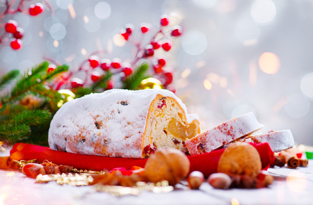 hazelnuts: Christmas stollen. Traditional sweet fruit loaf with icing sugar
