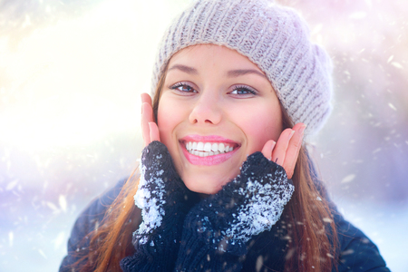 Joyful beauty girl having fun in winter park