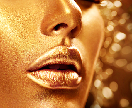 Beauty model girl with golden skin. Fashion art portrait Reklamní fotografie