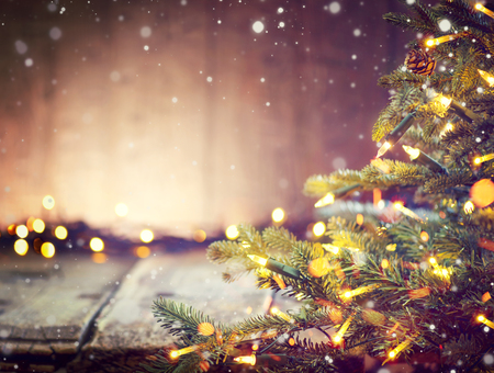 christmas decorations: Christmas holiday blurred background with Christmas tree and garlands