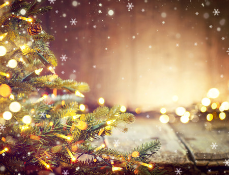 table top: Christmas holiday blurred background with Christmas tree and garlands