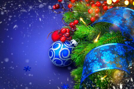 Christmas and New Year holiday background. Decorated Christmas tree over blue