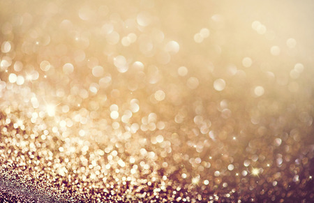 blink: Abstract golden holiday glowing background Stock Photo