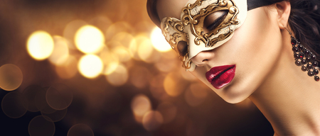 black mask: Beauty model woman wearing venetian masquerade carnival mask at party. Christmas and New Year celebration