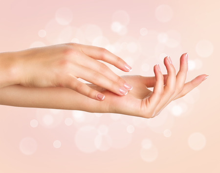 aging: Beautiful woman hands. Spa and manicure concept. Female hands with french manicure