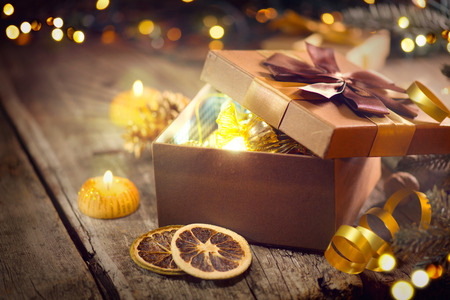 Christmas and New Year brown gift box. Holiday background Фото со стока