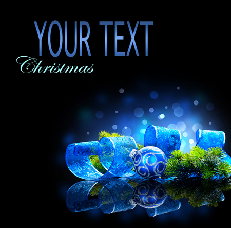 copyspace: Blue Christmas and New Year decoration isolated on black background. Border art design