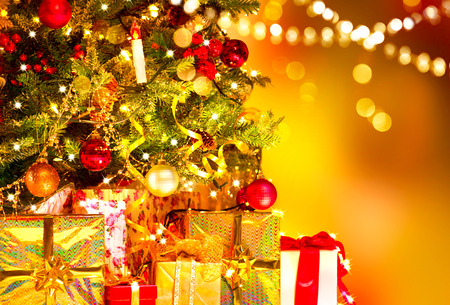 Holiday Christmas scene. Gifts under the Christmas tree Stock Photo