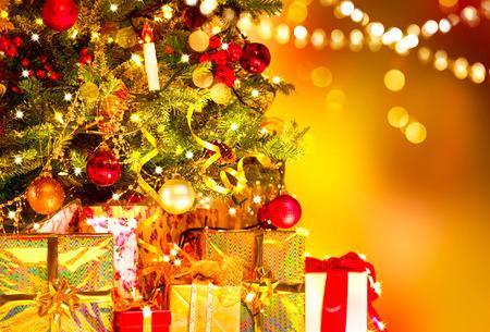 christmas gift: Holiday Christmas scene. Gifts under the Christmas tree