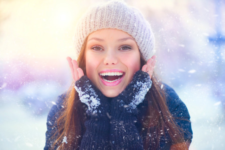 happy holidays: Winter girl portrait. Joyful teenage model girl having fun in winter park
