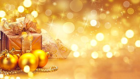 golden: Christmas and New Year golden baubles and decorations. Winter holiday art design
