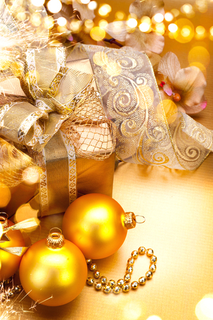 christmas gift: Christmas and New Year golden baubles and decorations. Winter holiday art design