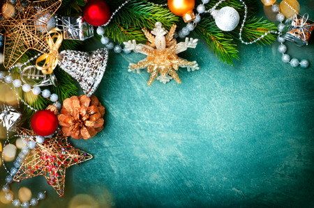 sepia.: Christmas vintage green background with retro styled baubles