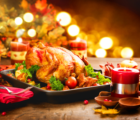 Christmas dinner. Roasted turkey. Winter holiday table decorated with candles