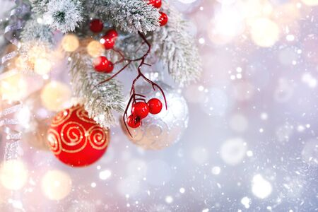 Christmas holiday abstract silver background, Hanging baubles on Christmas tree Stock Photo