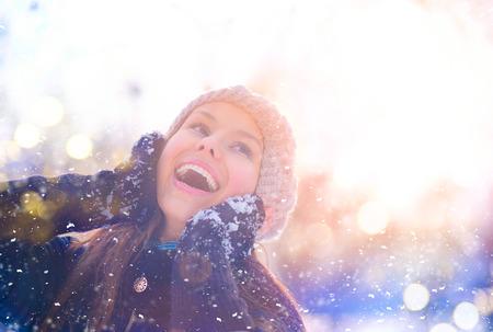 cold: Winter girl portrait. Joyful teenage model girl having fun in winter park