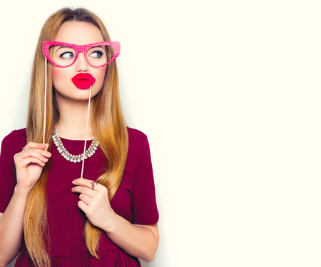 fillers: Funny young woman holding glasses and red lips on stick